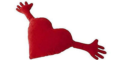 red heart shaped pillow with hands