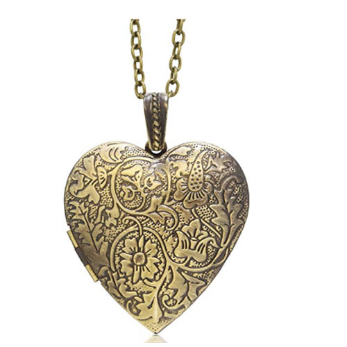 Old gold heart shaped locket flower engraved