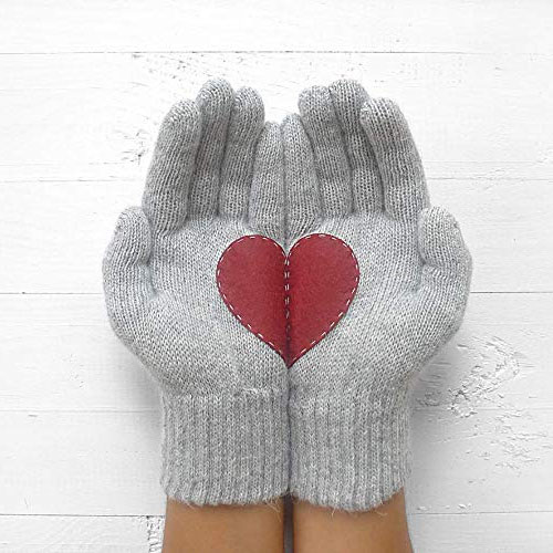 Grey gloves with red heart broken in two halves