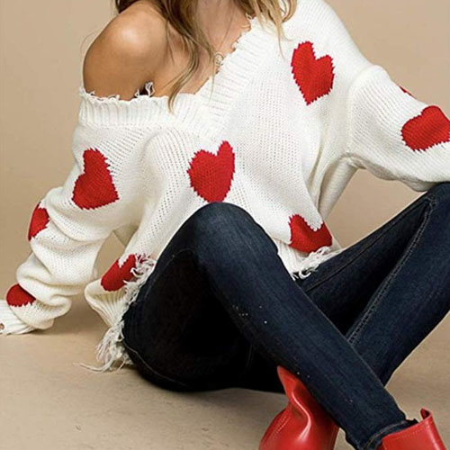 white cozy sweater for woman with red hearts on it