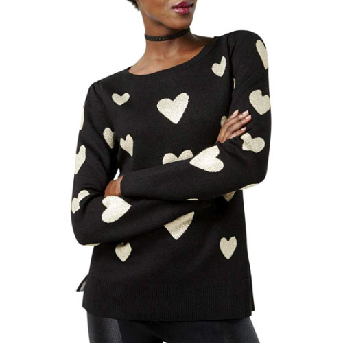 knitted sweater with white heart symbols on it