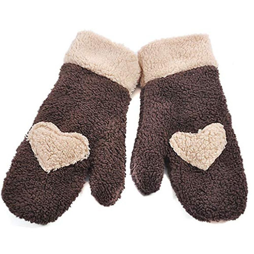 Brown cozy gloves with big hearts printed on its reverse