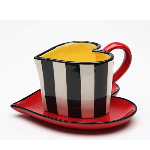Ceramic mug with the shape of a heart symbol