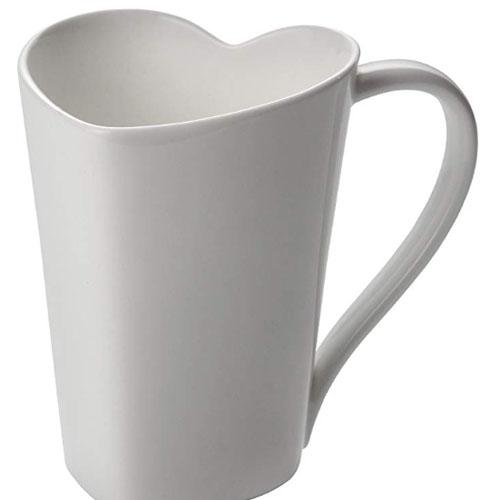 White coffee mug with the shape of a heart