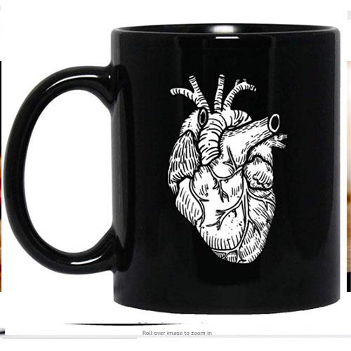 Black ceramic tea mug with white anatomical heart prints