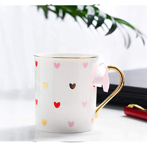 Cute heart teacup with golden handle
