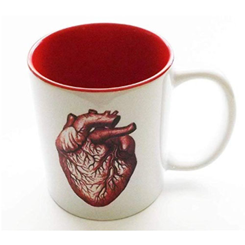 Ceramic coffee cup with red anatomical heart on it