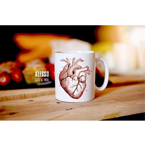 Painting of an anatomical heart on ceramic coffee cup