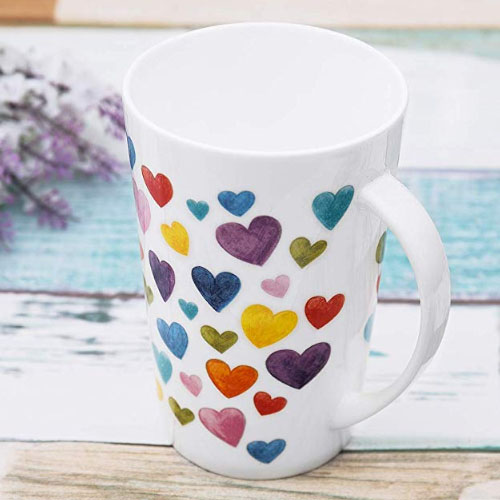 Artistic heart symbol on a ceramic tall tea cup